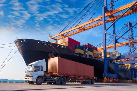 Transportation Cargo Ship Being Unloaded At Port