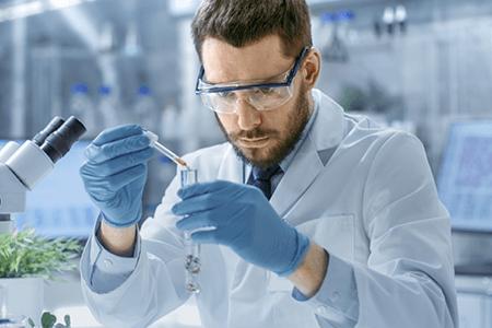 Lab Man With Eye Dropper & Test Tube