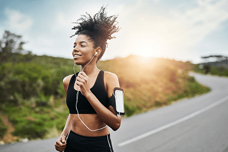 Products Athletic Woman Jogging with Headphones & Cellphone