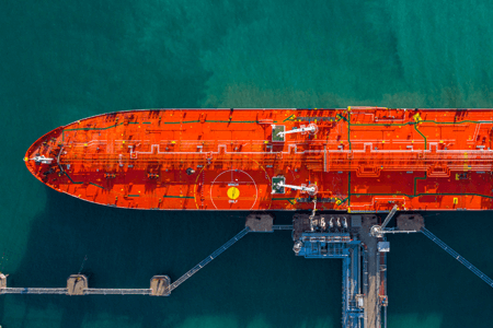 Cargo Ship Loading Chemicals at Port