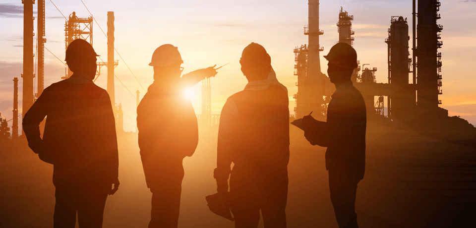 Employees Discuss Safety Measures at Dusk