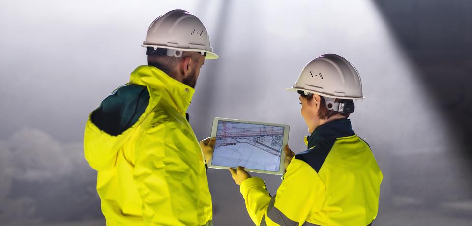 Building Inspectors Looking at Tablet Blueprints