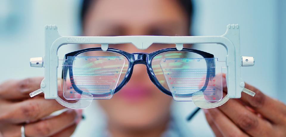 Ophthalmologist Examining Glasses