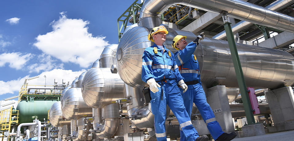 Two Workers Walking Through Chemical Facility