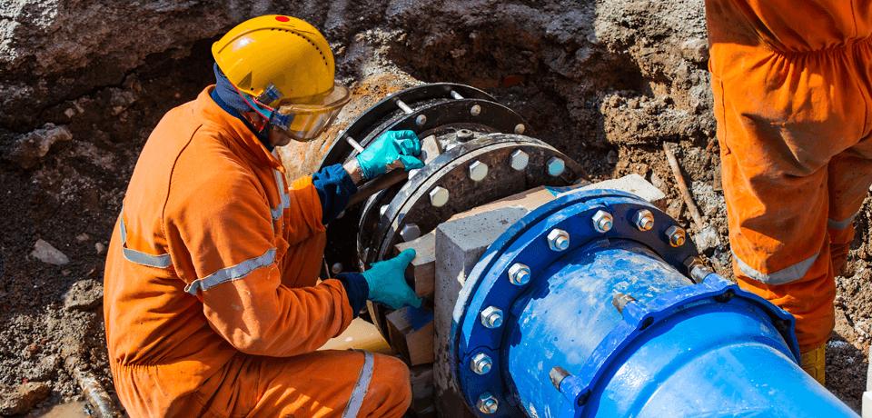 Construction Worker Fixes Broken Water Pipe