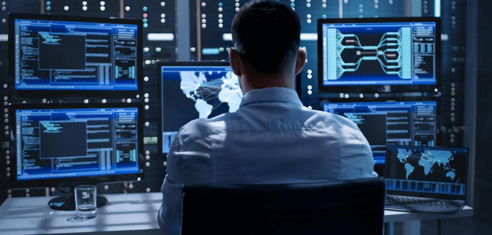 Employee at Computer Station Monitoring Traffic
