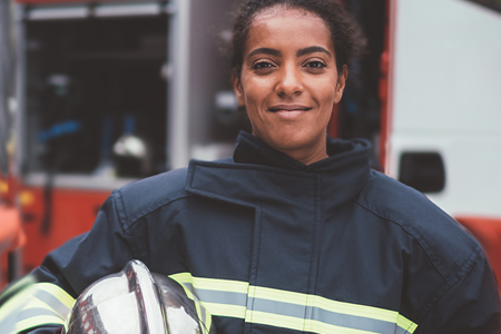 Firefighter Posing in Front of Fire Engine