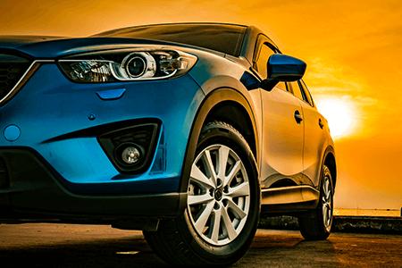 Blue Car in Sunset