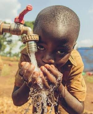 Child Drinking Water from Spicket