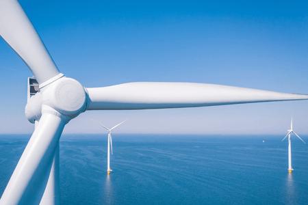 Wind Turbines Generating Electricity in Open Ocean