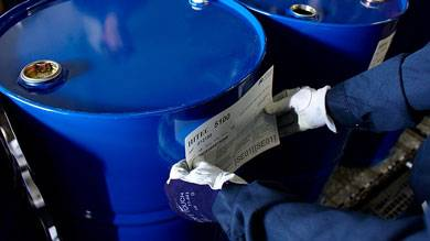 Afton Chemical Corporation Drums Being Labeled